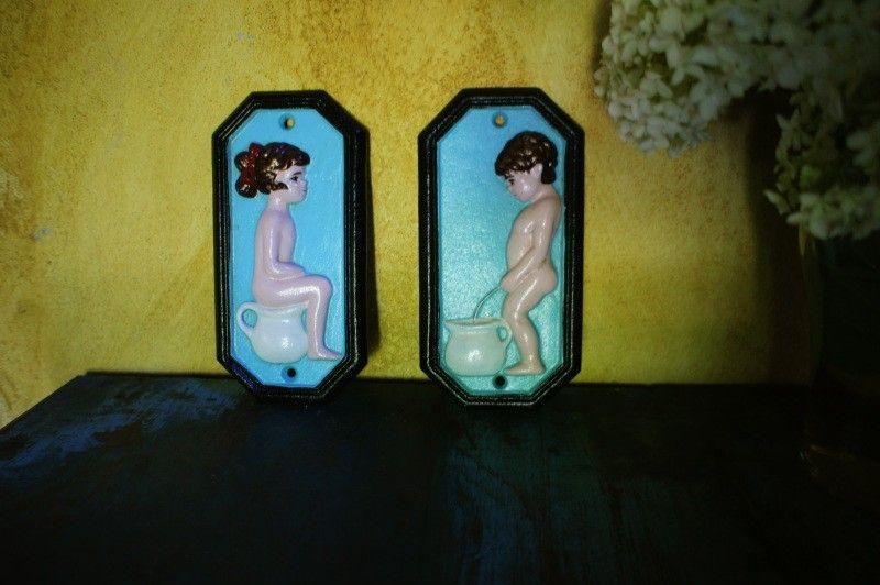 Set van tekens voor de wc deur gietijzer geschilderd man vrouw